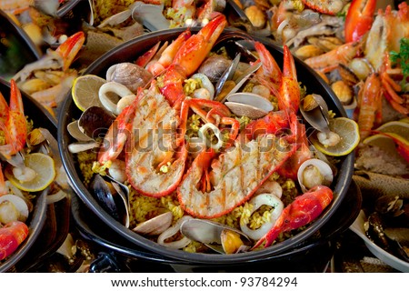 Seafood dish of lobster, prawns, squid, mussels. - stock photo