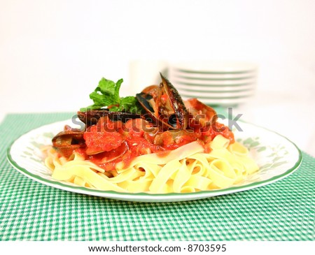 Seafood fettucine with tomato sauce - stock photo