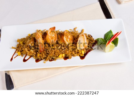 Seafood Fried Rice on Square Plate at Place Setting - stock photo