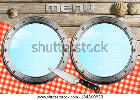 Seafood - Menu Template / Two empty metal portholes, kitchen knife and red checked tablecloth, template for recipes or seafood menu - stock photo