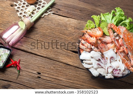 seafood mixed thai food traditional on wooden background ingredient - stock photo