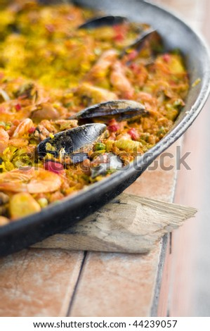 seafood paella in pan - stock photo
