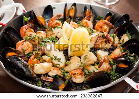 seafood paella in the fry pan - stock photo