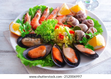 Seafood Paella on plate on table close-up - stock photo