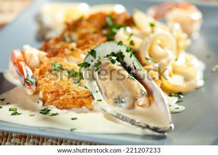 Seafood Pancake with Tiger Shrimps, Calamari, Mussels and Cream Sauce - stock photo
