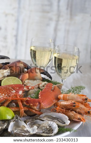 seafood  platter with glass of white wine - stock photo