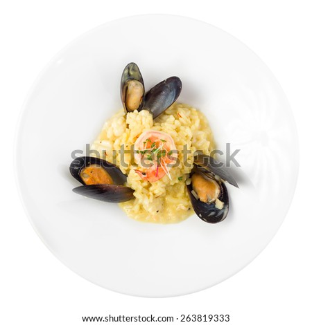 Seafood risotto with shrimp and mussels isolated on white background - stock photo