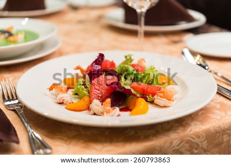 Seafood salad on a white plate - stock photo