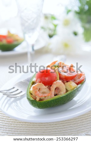 Seafood salad with mayonnaise and balsamic dressing in avocado - stock photo