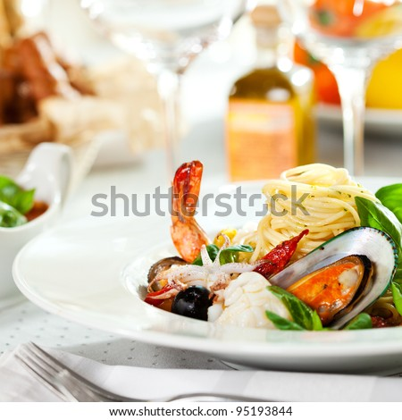 Seafood Spaghetti with Tiger Prawns, Scallops, Mussels, Calamari, Salmon and Tomato Sauce - stock photo