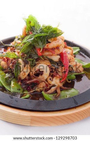 Seafood stir fried with Thai herb. - stock photo