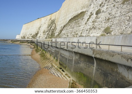 Seafront promenade under chalk cliffs between Brighton Marina and Rottingdean. East Sussex. England - stock photo