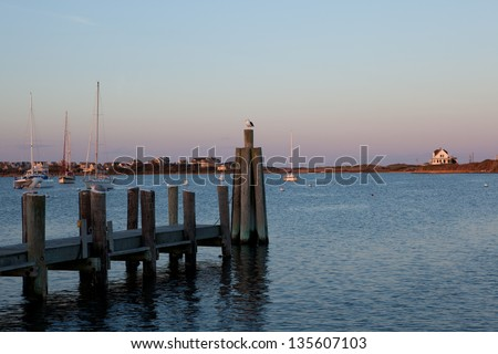 Seagulls enjoying sunset at the Great Salt Pond at Block Island, Rhode Island - stock photo