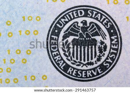 Seal of the Federal Reserve System on the banknote one hundred dollars USA - stock photo