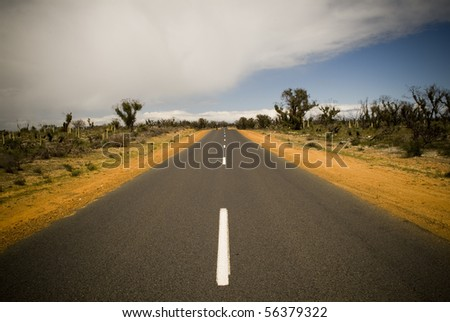 Sealed road in Australian outback - stock photo