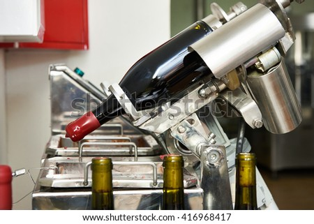Sealing bottles of wine at the winery - stock photo