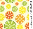 seamless background with lemon, lime, orange and grapefruit. Raster version - stock photo