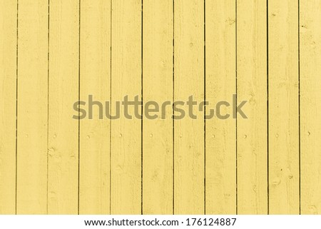 Seamless empty space background of vintage textured yellow wooden wall with rough weathered surface - stock photo