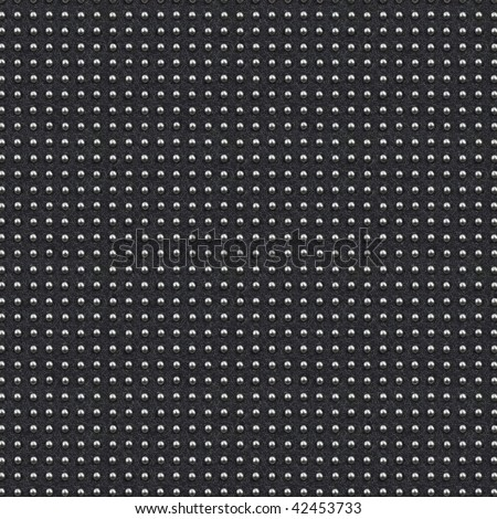 seamless texture of artificial grey leather with regularly placed metal dot - stock photo