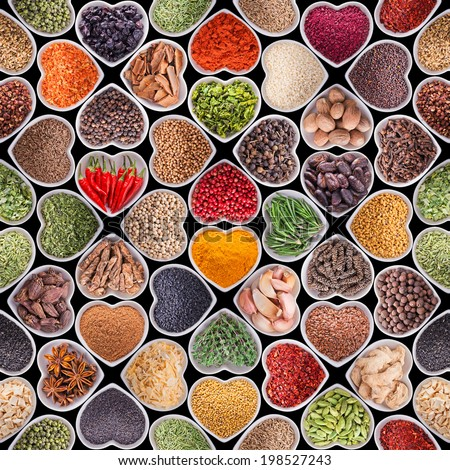 Seamless texture with spices and herbs over black background - stock photo