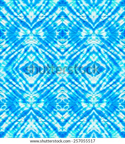 seamless tie dye pattern with mirror center. symmetric rhombus design. traditional coloring technique. - stock photo