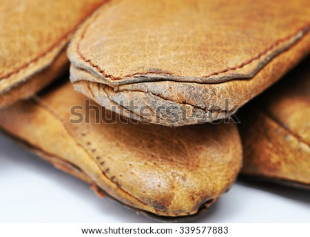 Seams on work gloves. Macro with extremely shallow dof. - stock photo