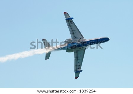 Seaplane Be200 on aviashow after dump of water - stock photo