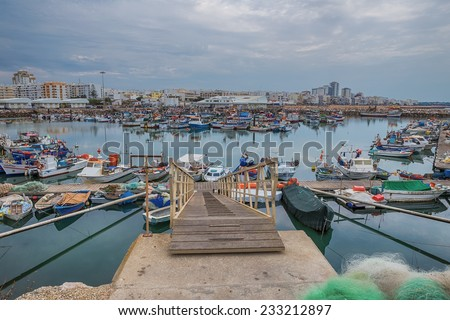 Seaport berth for ships. Fish industry in Portugal. Quarteira. - stock photo