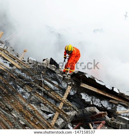 Search and rescue forces search through a destroyed building with the help of rescue dogs.  - stock photo