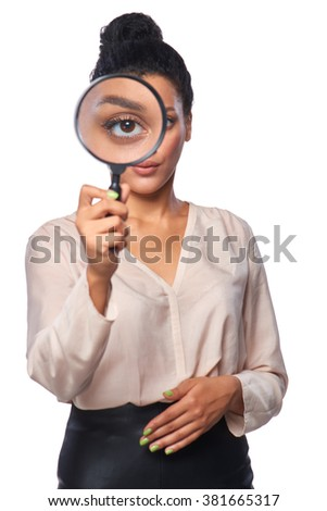 Search concept. Serious business woman standing looking at the camera through magnifying glass, isolated over white - stock photo
