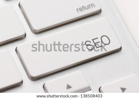 search optimization button on the keyboard close-up - stock photo