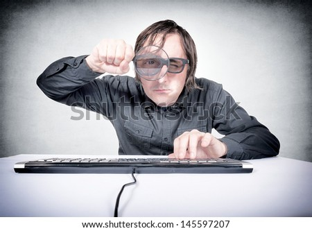 Searching concept with the man holding magnifier - stock photo