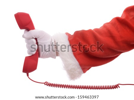 Searching for christmas he perfect gift or bargain, santa's hand holding a magnifying glass isolated on a white background - stock photo