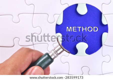 """Searching for missing """"Method"""" word puzzle using the magnifying glass  - stock photo"""