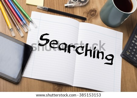 Searching - Note Pad With Text On Wooden Table - with office  tools - stock photo