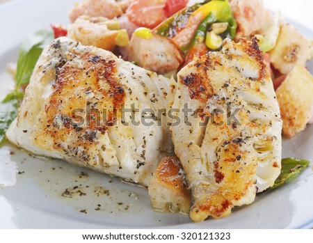 Seared Mahi Mahi Fillets with Vegetables and Sauce - stock photo