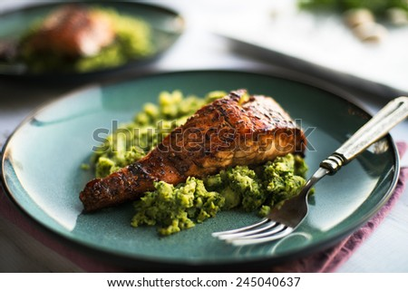 Seared salmon with a sweet glaze over sweet potato noodles - stock photo