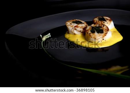 Seared Scallops on Black Plate - stock photo