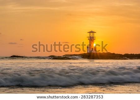 Seascape at sunset. Lighthouse on the coast - stock photo