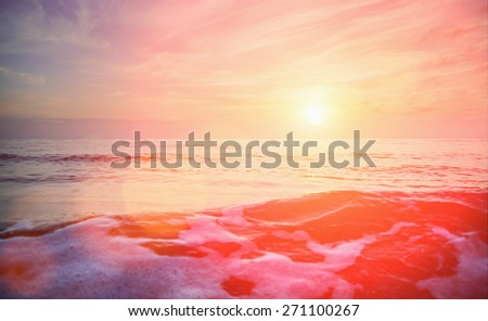 Seascape. Beautiful sunset over the sea. In the foreground wave with foam. Image with sunlight effect - stock photo