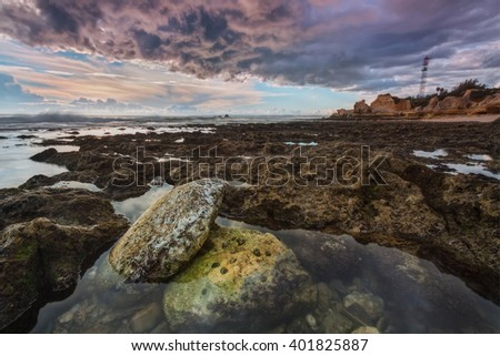 Seascape before the storm and rain. Albufeira Gale Beach. - stock photo