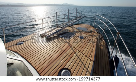 seascape boat on the high seas clear sunny day - stock photo