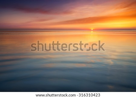 Seascape during sunrise. Beautiful natural summer seascape - stock photo