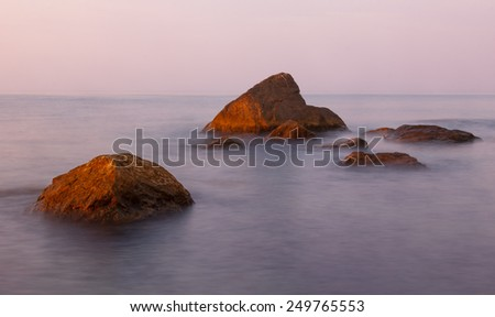 Seascape in the early morning with stones and rocks in the minimalist style. Black Sea, Crimea - stock photo