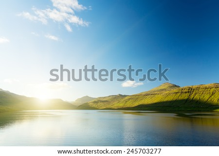 Seascape, mountains on the horizon. The Faroe Islands. The sunrise. - stock photo