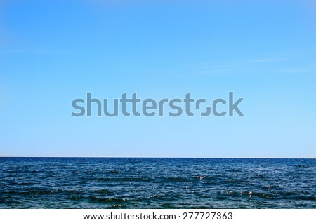 Seascape of Deep Blue Ocean Water with Flat Horizon and Big Clear Blue Sky - stock photo