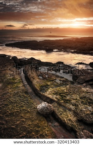 Seascape of the Portuguese coastline at sunset light - stock photo