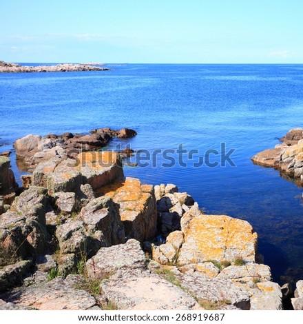 Seascape rock in water - Christiansoe island Bornholm in the Baltic Sea Denmark Scandinavia Europe - stock photo