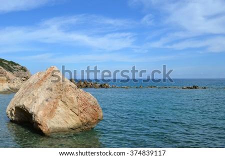 Seascape scene with boulder in the sea - stock photo