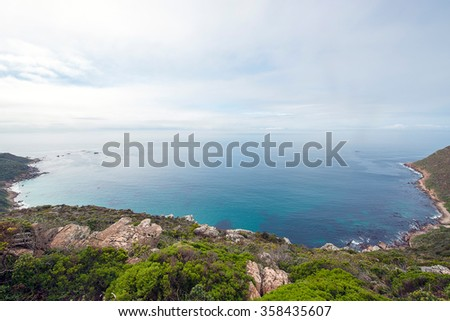 seascape simonstown south africa with mountains looking down to the ocean - stock photo